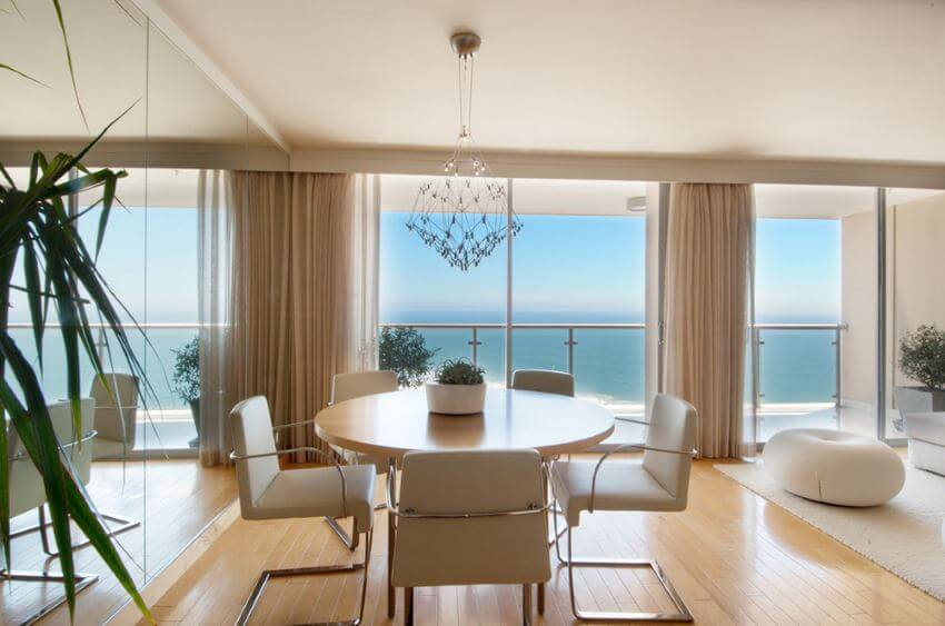 Dining-room-with-a-mirrored-wall-and-an-ocean-view